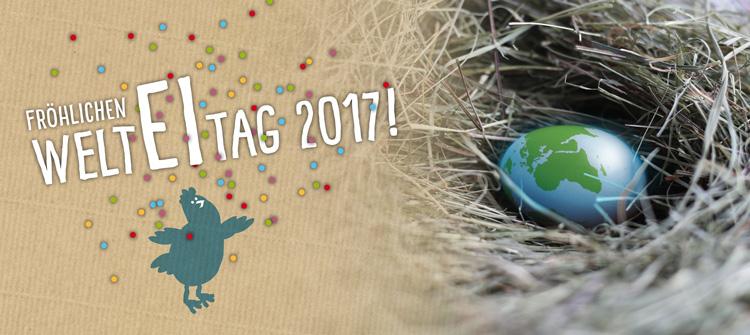 Dein Land Ei zeigt ein Ei als Weltkugel in einem Nest und wünscht einen fröhlichen Welt Ei Tag 2017.